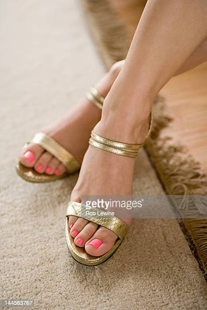 USA, California, Los Angeles, Golden sandals on female foot
