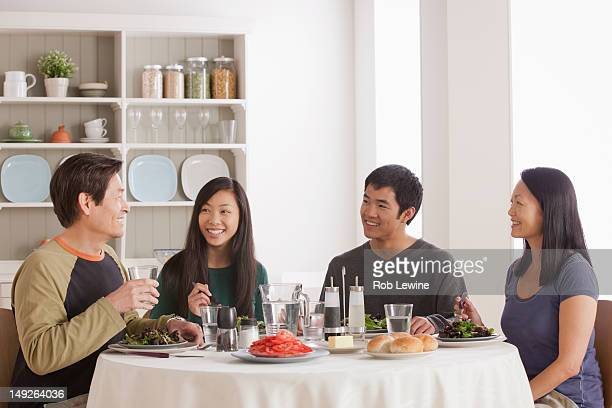 USA, California, Los Angeles, Happy family having meal together