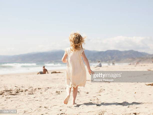 USA, California, Los Angeles, Happy young girl (4-5) running on beach