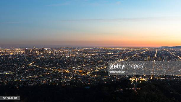 USA, California, Los Angeles, Illuminated cityscape at sunrise