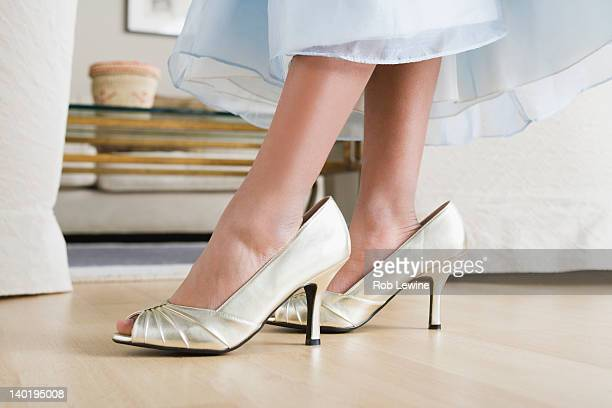 usa, california, los angeles, low section of girl (10-11) wearing oversized shoes - big foot stock photos and pictures