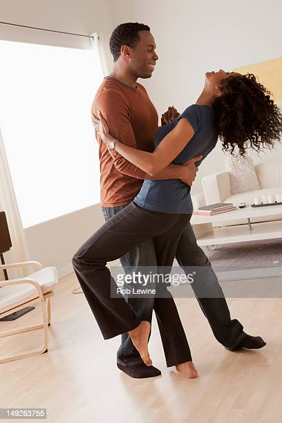 USA, California, Los Angeles, Mid adult couple dancing at home
