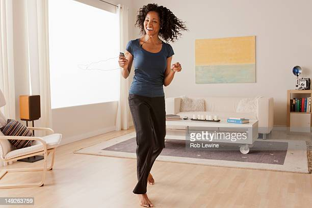 USA, California, Los Angeles, Mid adult woman dancing at home