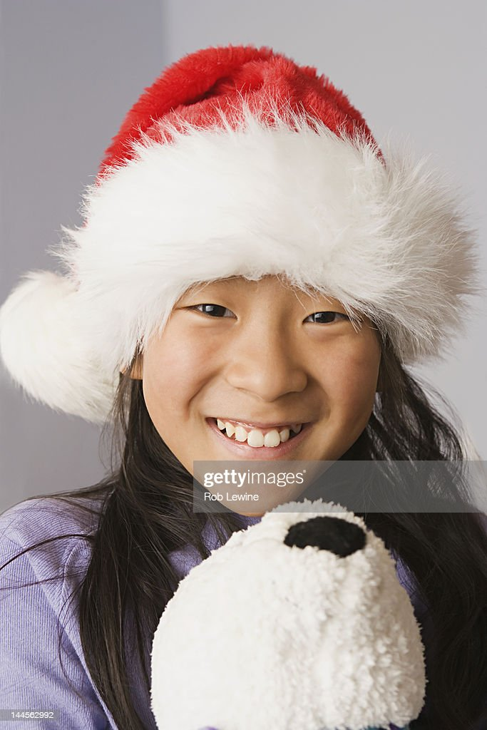 3e6032e630e ... discount usa california los angeles portrait of girl wearing santa hat  stock photo 319bc eb688