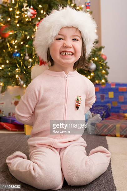 USA, California, Los Angeles, Portrait of girl with presents at Christmas morning