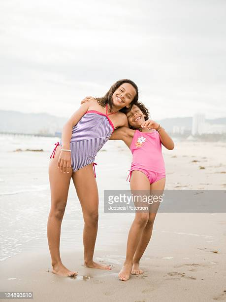 USA, California, Los Angeles, Portrait of two girls (6-11) on beach