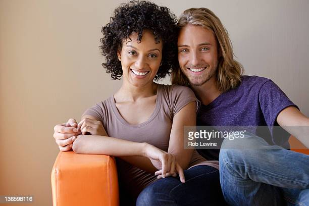 USA, California, Los Angeles, Portrait of young couple sitting in armchair