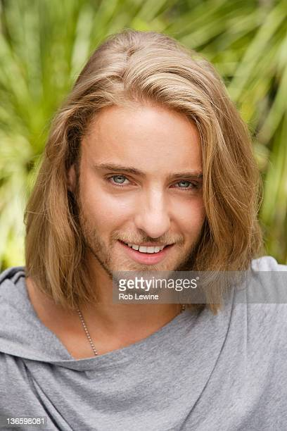USA, California, Los Angeles, Portrait of young man with long blond hair