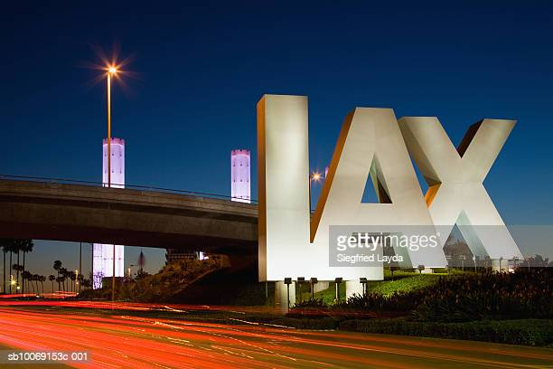 usa, california, los angeles, road to international los angeles airport, illuminated lax sign - lax airport stock pictures, royalty-free photos & images