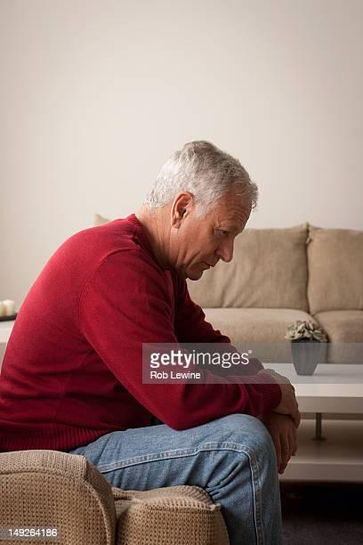 USA, California, Los Angeles, Sad senior man sitting on armchair