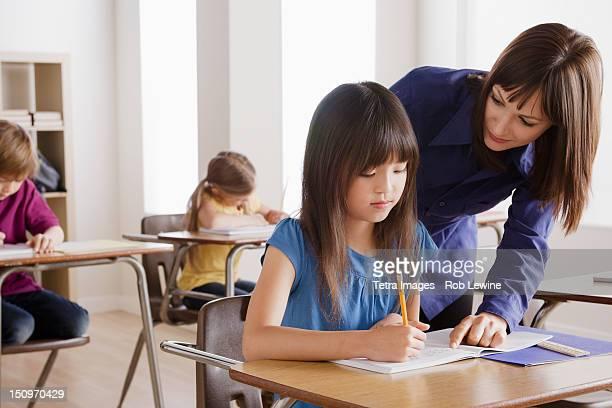 USA, California, Los Angeles, Schoolgirl with teacher