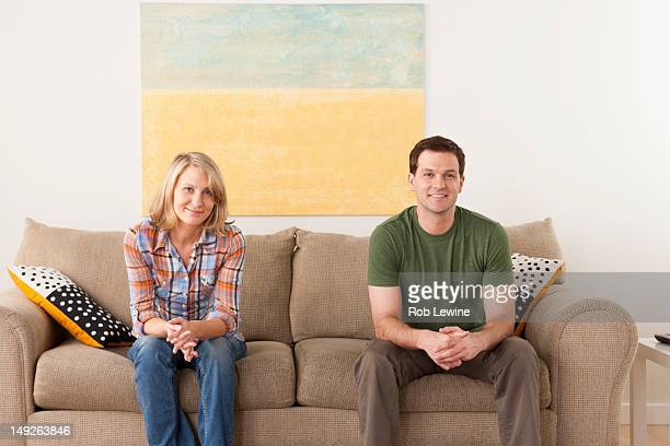 USA, California, Los Angeles, Smiling mid adult couple sitting on sofa