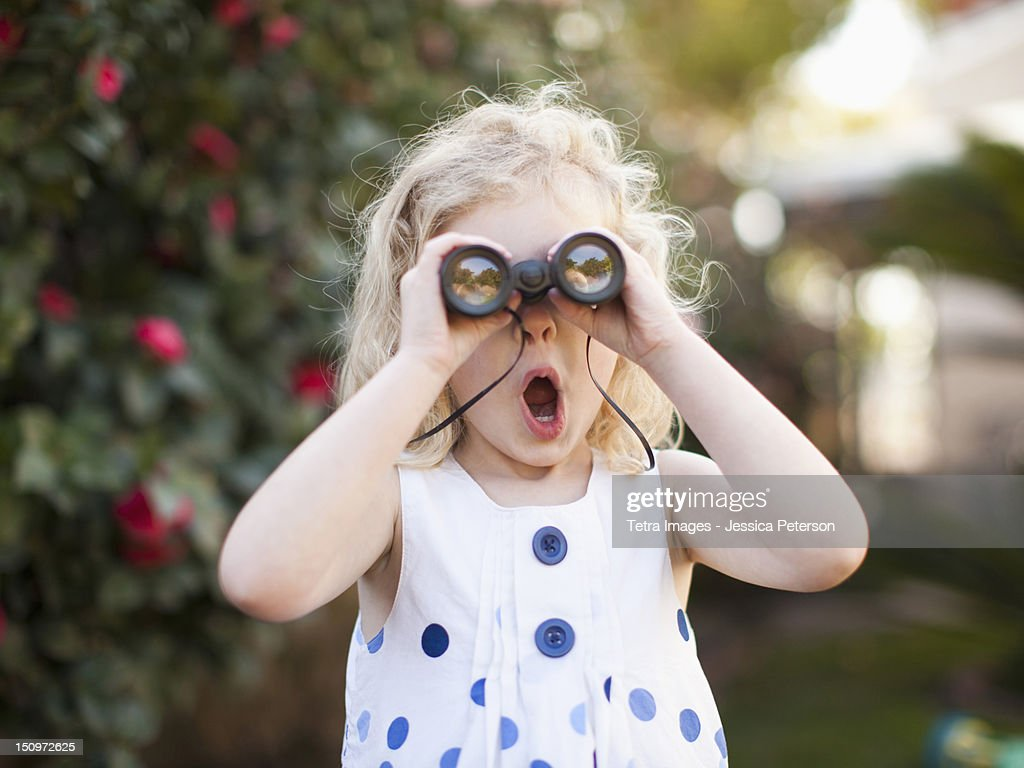 USA, California, Los Angeles, Surprised young girl (4-5) looking through binoculars : Stock Photo