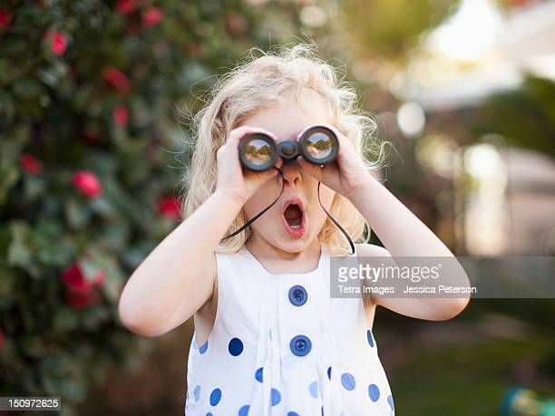 USA, California, Los Angeles, Surprised young girl (4-5) looking through binoculars