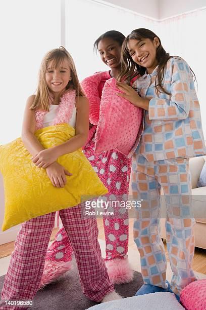 USA, California, Los Angeles, Three girls (10-11) having fun at slumber party
