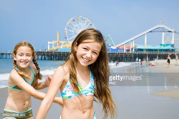 USA, California, Los Angeles, two girls (9-11) on beach, portrait