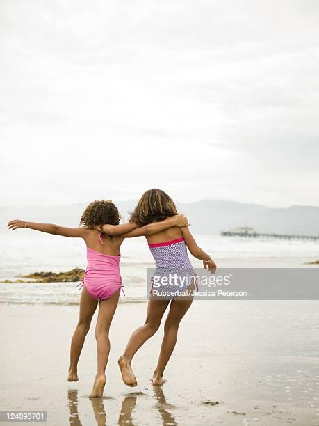 USA, California, Los Angeles, Two girls (6-11) walking on beach