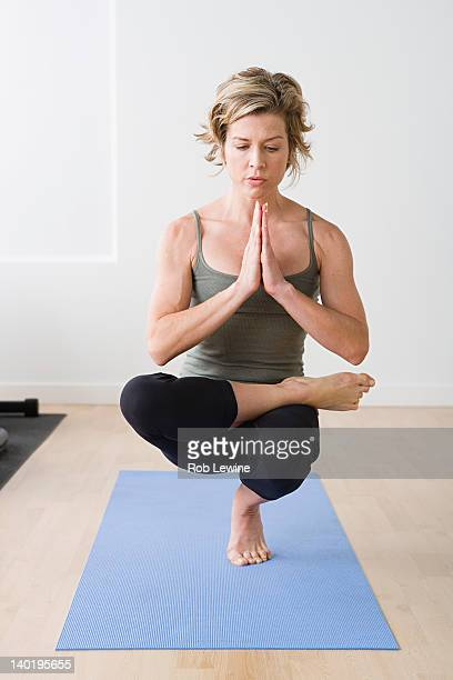USA, California, Los Angeles, Woman practicing yoga on mat