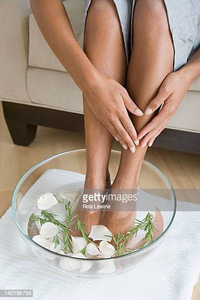 USA, California, Los Angeles, Woman soaking feet in water with petals