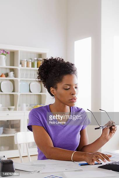 USA, California, Los Angeles, Young woman using calculator