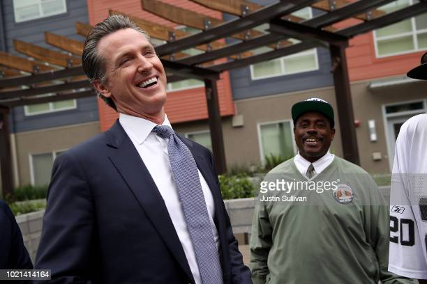 California Lt Gov and California gubernatorial candidate Gavin Newsom laughs with a resident as he visits the Alice Griffith Apartments on August 22...