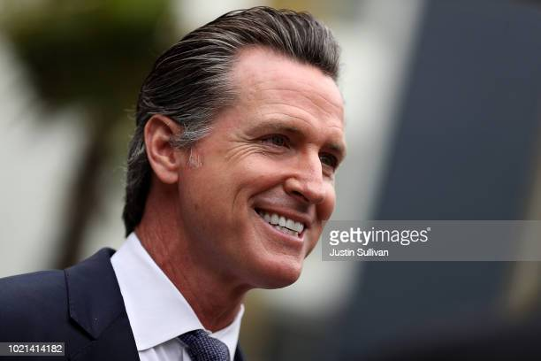 California Lt Gov and California gubernatorial candidate Gavin Newsom looks on as he visits the Alice Griffith Apartments on August 22 2018 in San...