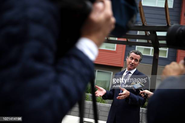 California Lt Gov and California gubernatorial candidate Gavin Newsom talks with members of the media as he visits the Alice Griffith Apartments on...