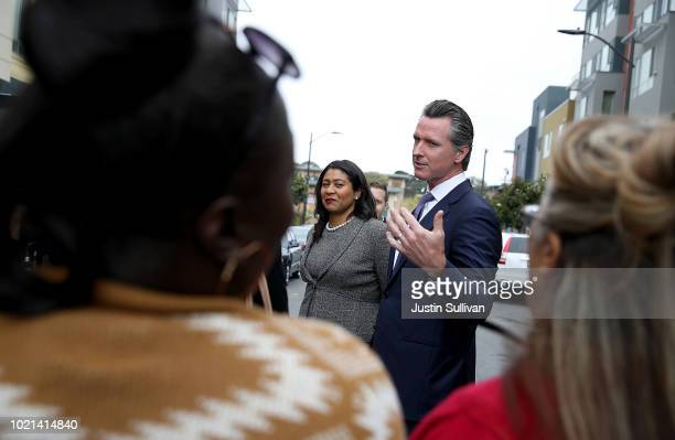 California Lt Gov and California gubernatorial candidate Gavin Newsom and San Francisco mayor London Breed talk with residents as they visit the...