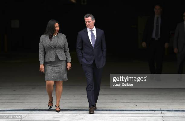 California Lt Gov and California gubernatorial candidate Gavin Newsom talks with San Francisco mayor London Breed as they visit the Alice Griffith...