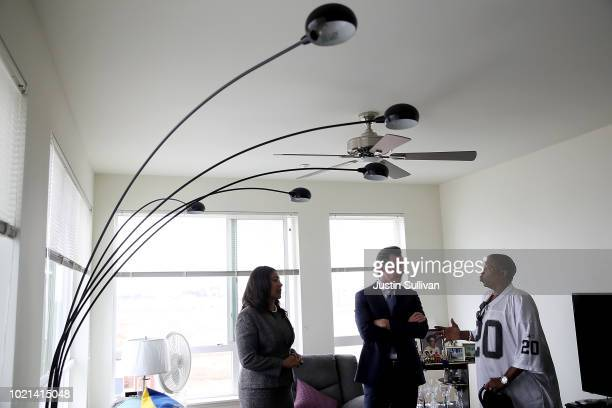 California Lt Gov and California gubernatorial candidate Gavin Newsom and San Francisco mayor London Breed talk with a resident as they visit the...