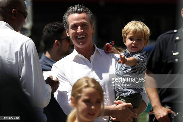 California Lt Gov and democratic candidate for California governor Gavin Newsom holds his two yearold son Dutch as he greets supporters during a...