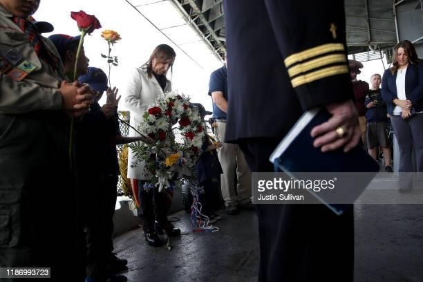 California Lt Gov Eleni Kounalakis holds a wreath as she bows her head in prayer during a Veterans Day celebration aboard the USS Hornet on November...