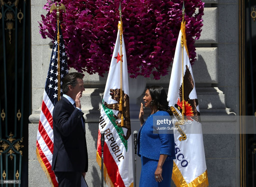 California Lt. Gov. Gavin Newsom (L) administers the oath of office to San Francisco mayor London Breed during her inauguration at San Francisco City Hall on July 11, 2018 in San Francisco, California. London Breed made history after being sworn in as the first black woman to be elected as mayor of San Francisco. Breed will finish out the term of former San Francisco mayor Ed Lee who died unexpectedly last year.