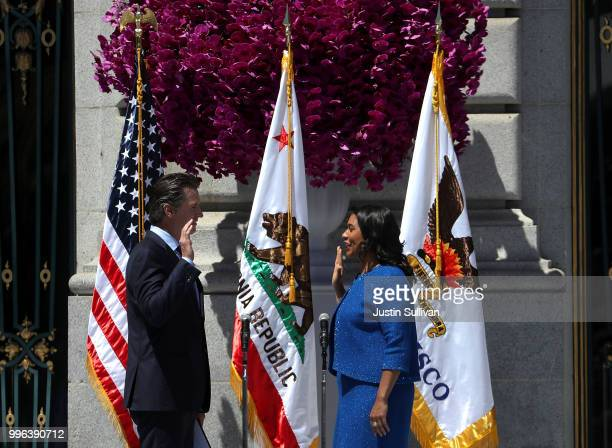 California Lt Gov Gavin Newsom administers the oath of office to San Francisco mayor London Breed during her inauguration at San Francisco City Hall...