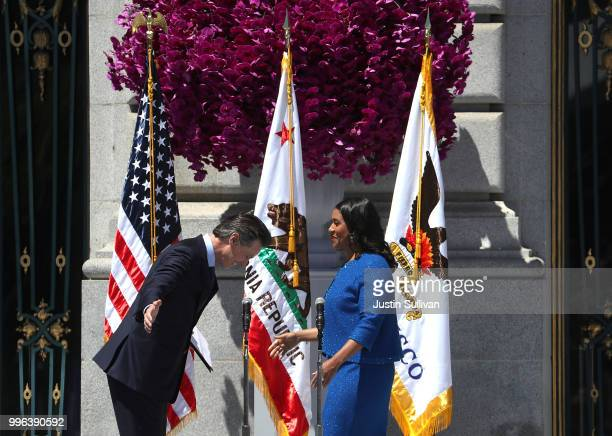 California Lt Gov Gavin Newsom bows in front of San Francisco mayor London Breed after she was sworn in during her inauguration at San Francisco City...