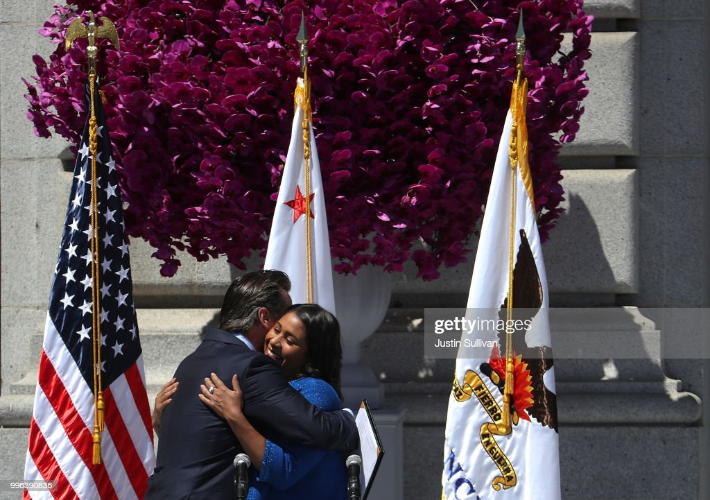 California Lt. Gov. Gavin Newsom (L) hugs San Francisco mayor London Breed during her inauguration at San Francisco City Hall on July 11, 2018 in San Francisco, California. London Breed made history after being sworn in as the first black woman to be elected as mayor of San Francisco. Breed will finish out the term of former San Francisco mayor Ed Lee who died unexpectedly last year.