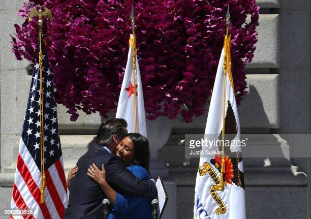 California Lt Gov Gavin Newsom hugs San Francisco mayor London Breed during her inauguration at San Francisco City Hall on July 11 2018 in San...