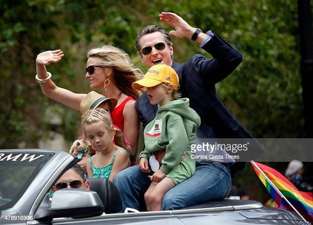 California Lt Gov Gavin Newsom rides in the San Francisco Pride Celebration and Parade with his wife Jennifer Siebel Newsom and their children on...