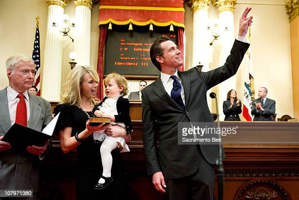 California Lt Gov Gavin Newsom waves to a guest in the Senate chambers before being his swearingin ceremony on Monday January 10 in Sacramento...