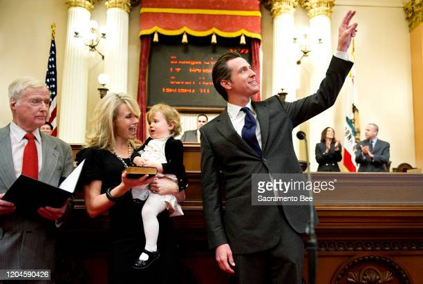 California Lt Gov Gavin Newsom waves to a guest in the Senate chambers before being his swearingin ceremony on Jan 10 in Sacramento Calif Newsom's...