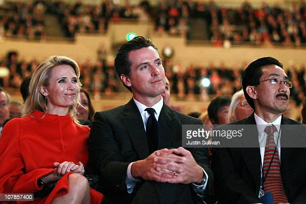California Lt governor elect Gavin Newsom and his wife Jennifer Siebel Newsom look on as Jerry Brown delivers remarks after he was sworn in as the...