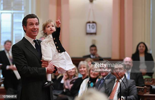 California Lt Governor Gavin Newsom holds his daughter Montana as he speaks after being sworn in as the 49th Lt Governor of California at the...