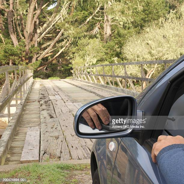 USA, California, man preparing to drive over wooden bridge