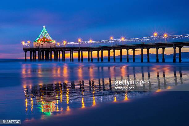 usa, california, manhattan beach, illuminated pier at dusk during christmas time - beach christmas stock pictures, royalty-free photos & images