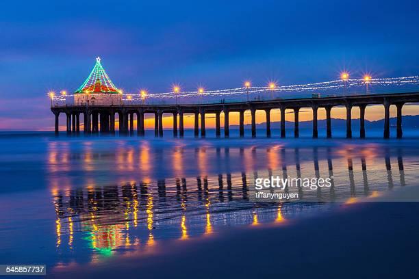 USA, California, Manhattan Beach, Illuminated pier at dusk during Christmas time