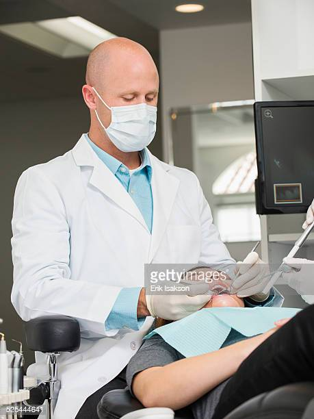 USA, California, Mission Viejo, Dentist operation on patient