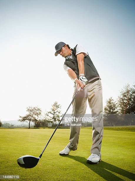 usa, california, mission viejo, low angle view of man playing golf - golf swing stock pictures, royalty-free photos & images