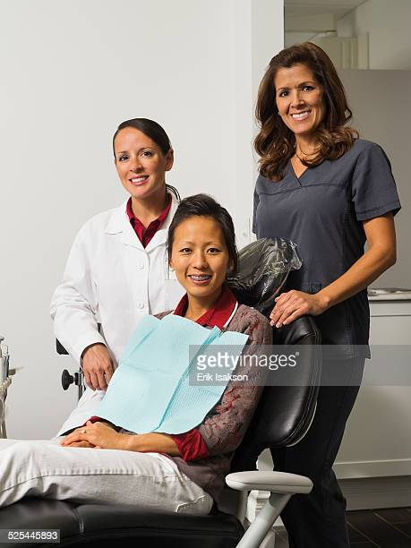 USA, California, Mission Viejo, Portrait of dentist with patient and assistant