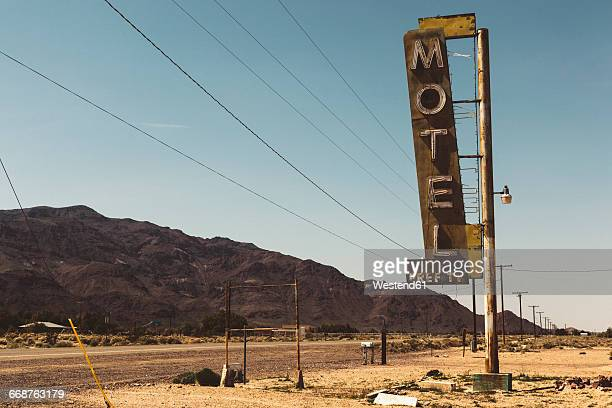 USA, California, Mojave Desert, sign of abandoned motel at route 66