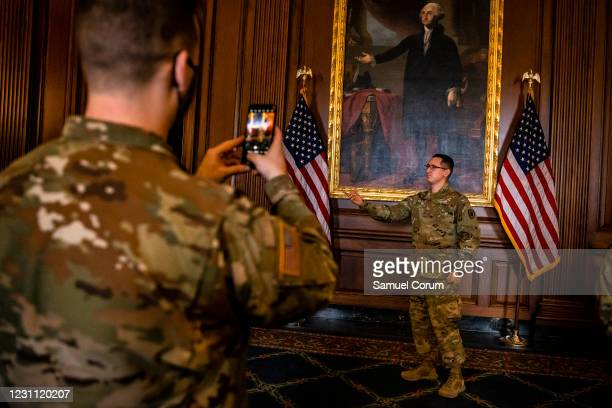 California National Guard soldier mimics George Washingtons pose in the painting behind him after enjoying breakfast that was provided by House...